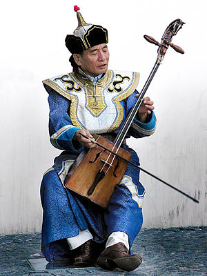 Bowed string instrument - A performer playing the Morin Khuur, the Mongolian Horse Fiddle