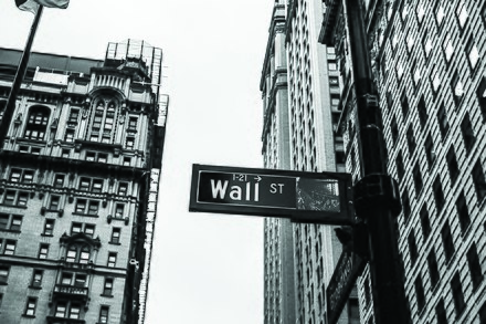 Epstein joined Bear Stearns in 1976 and learned the art of finance and trade on Wall Street in New York City. Monochrome wall street sign (Unsplash).jpg