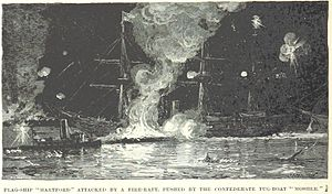 USS Hartford (1858) - Hartford is attacked by a fire raft at the Battle of Forts Jackson and St. Philip