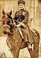 Mysykkaty Tembolat on horseback.jpg