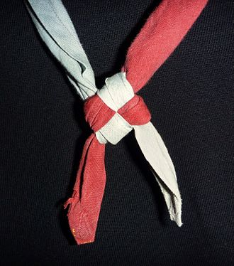 Friendship knot - A two-coloured Scout neckerchief tied with a friendship knot.