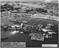 NASPH ^119944- 3 Nov 1943, USS Oklahoma- Salvage- Aerial view from port side aft during pumping operations for... - NARA - 296957.tif