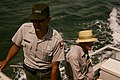 NPS employees, George F. Schesventer and Dr. Craighead on a boat in Biscayne National Park. (95268b21d5074f52a8ffb0067779d401).jpg