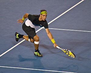 Headband - Rafael Nadal wearing green head band during a tennis match
