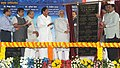 Narendra Modi unveiling the plaque for the laying of the foundation stone for Nagpur Metro, in Nagpur, Maharashtra. The Governor of Maharashtra, Shri K. Sankaranarayanan, the Union Minister for Urban Development.jpg
