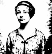 A young woman facing a camera, staring toward the right