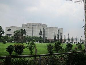 Large, modern building on landscaped grounds
