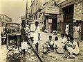 Natives have breakfast on a sidewalk in Calcutta in 1945.jpg