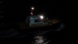 Pilot boat - Pilot boat in Almeria, Spain, showing the white-over-red night lighting.