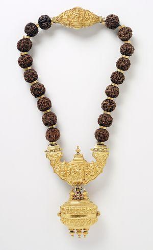 Jangam - A necklace with pendant containing Linga symbol of Shiva are worn by Jangam Community