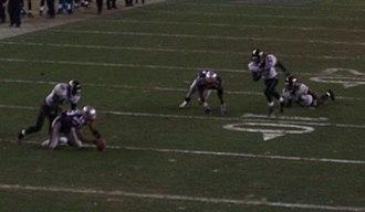 2005 New England Patriots season - André Davis (left) recovers a Benjamin Watson fumble