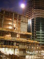 Nighttime shot of the Infinity (300 Spear Street) construction site, showing the pit, the Main Street midrise and tower II, SF.JPG