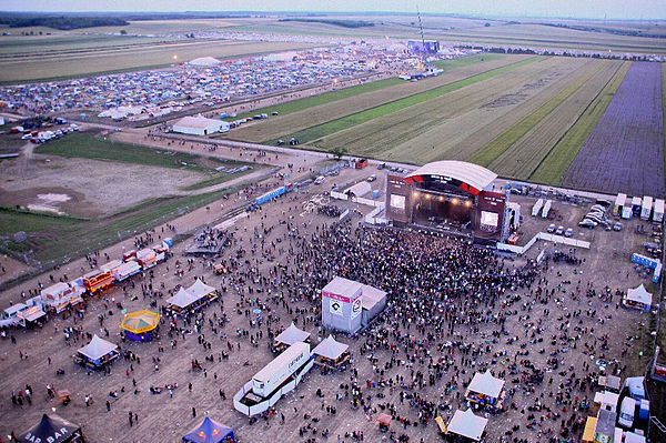 Music festival in Nickelsdorf, Austria, picturing both the main stage and the camping grounds on the farm behind Novarock1.jpg