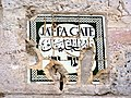 Old Jerusalem Jaffa Gate Bezalel ceramic sign from below (damaged).jpg