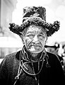 Old man wearing traditional fur hat, Ladakh.jpg