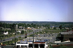 Orleans, Ontario - Orléans on June 1, 1982 (Place D'Orléans to the left, Champlain St. to the right, the Champlain/Highway 17 intersection and the old Normandy Hotel to the upper right) as viewed from the ridge of the Duford hill leading into Queenswood Heights.