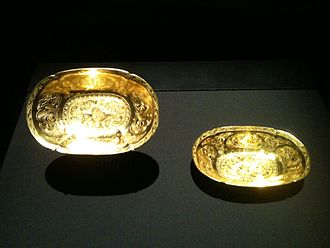 Belitung shipwreck - Two oval lobed gold bowls each with two ducks in repoussé among chased flowers