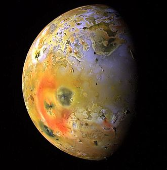 Io (moon) - Enhanced-color Galileo image showing a dark spot (interrupting the red ring of short-chain sulfur allotropes deposited by Pele) produced by a major eruption at Pillan Patera in 1997