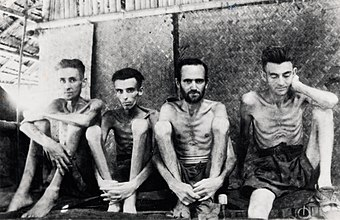 Netherlands and Australian PoWs of the Empire of Japan in 1943. The Fall of Singapore to Japan marked the greatest defeat in British military history. POWs Burma Thai RR.jpg