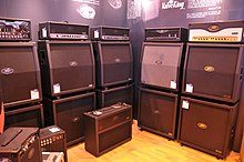A selection of Peavey amplifier head units and speaker cabinets are shown.