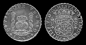 Dollar sign - Silver 8 real coin of Philip V of Spain, 1739 - This earlier example pre-dates other explanations by at least 30 years.
