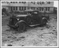 Photograph of a machine-gunned army truck at Hickam Field, Hawaii, after the attack on Pearl Harbor - NARA - 306550.tif