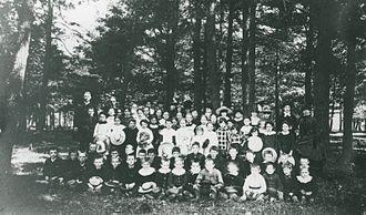 Mooney's Bay Park - A photograph of a group of Mooney and Carty children at a picnic at the Narrows Lockstation circa 1900