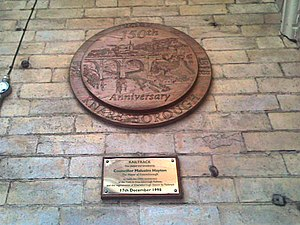 Knaresborough railway station - A plaque unveiled by the late Malcolm Hayton in 1998 celebrating the extension of the railway from York to Knaresborough 150 years previously.