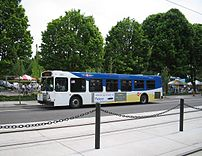 TriMet bus parked near MAX tracks (helping out...