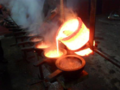 Pouring into Cast at Supernaturals Cymbals Foundry Istanbul.png