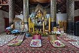 Praying area inside the temple Wat Jom Phet of Luang Prabang Laos.jpg
