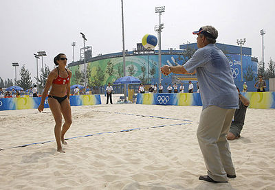 President George W. Bush sends a ball back to United States team member Misty May-Treanor (pool B), during his visit to the Chaoyang Park practice courts on August 9, 2008, before the U.S. team began their matches. President George W. Bush plays volleyball 2008 Olympics.jpg