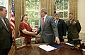 President George W. Bush shakes the hands of Janet and Bill Norwood after signing into law H.R. 1001.jpg