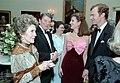 President Ronald Reagan and Nancy Reagan talking to Ariana Huffington and Mike Huffington.jpg