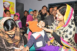 Pulse vaccination strategy - On Pulse Polio Day, a child swallows vaccine drops and is marked as vaccinated (felt-nib pen on finger). The Pulse Polio immunisation campaign eliminated polio from India.