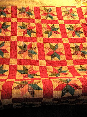 my new (new to me) antique quilt! i lurve it.