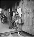 "REA, ""Man washing hands in bowl, woman in background"" - NARA - 195868.tif"