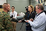 Reporters interview U.S. Marine Corps Col. John Merna, the commanding officer of the 31st Marine Expeditionary Unit, aboard the amphibious assault ship USS Bonhomme Richard (LHD 6) during Talisman Saber 2013 130730-N-UE577-015.jpg