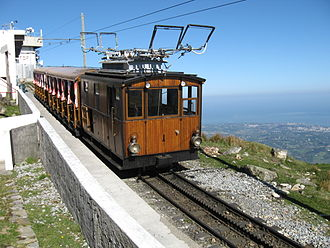 Petit train de la Rhune - Train at summit station, showing the twin wires of the three-phase supply. The Atlantic coast can be seen in the background.