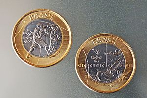 Brazilian real -  Commemorative 1 real coins for the 2016 Summer Olympics and Paralympics Games in Rio de Janeiro. Left, allegory to Olympic boxing, right, allegory to Paralympic swimming.