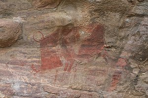 "Bhimbetka rock shelters - The only painting in the caves showing, ""a man"" being hunted by a beast, a horned boar"