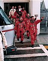 STS-71 crew leaves Operations & Checkout building.jpg