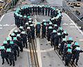 Sailors aboard USS Chancellorsville commemorate sexual assault prevention month. (26716555545).jpg