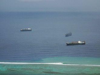 Strategic sealift ships - USNS PFC Dewayne T. Williams, USNS Dahl, and USNS Maj. Stephen W. Pless anchored off the coast of Saipan in June 2011