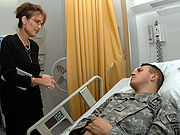 Palin visits a wounded soldier in Landstuhl, Germany, July 2007
