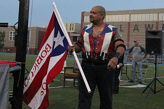 Savio Vega - Vega with a Los Boricuas flag in June 2013
