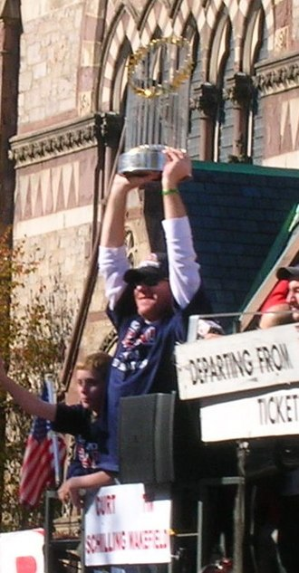 Curt Schilling - Curt Schilling hoisting the Commissioner's Trophy during the Red Sox 2007 World Series Parade.