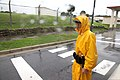 Security guard Atsushi Shimabukuro stands at the gate of U.S. Marine Corps Base Camp Smedley D. Butler in Okinawa, Japan, Oct. 28, 2010, to check identifications and talk to drivers about weather conditions 101028-M-VG363-045.jpg