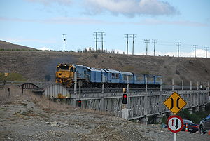 Coastal Pacific - The TranzCoastal crossing the double-decker rail and road bridge near Seddon in April 2007