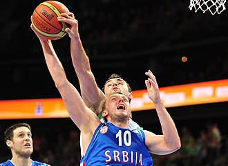 Block (basketball) - Mirza Begić blocks Duško Savanović at the EuroBasket 2011
